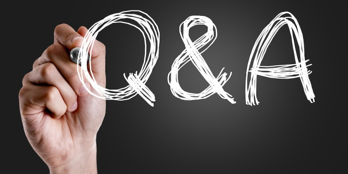 Hand writing the text: Q&A